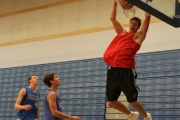  . . . for a slam during the Alumni tournament.